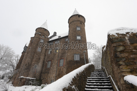 snow covered ancient castle in town