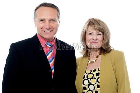 senior couple posing over white background