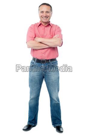 casual aged man standing on white