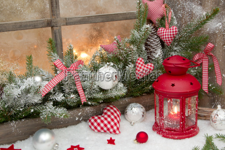 red rustic christmas decoration on window