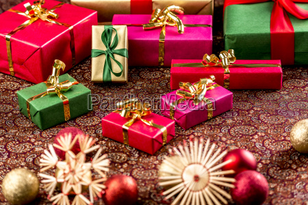 christmas gifts on richly textured clothr
