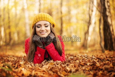 smiling woman relaxing in the park