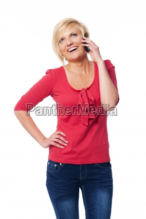 attractive blonde woman talking on her