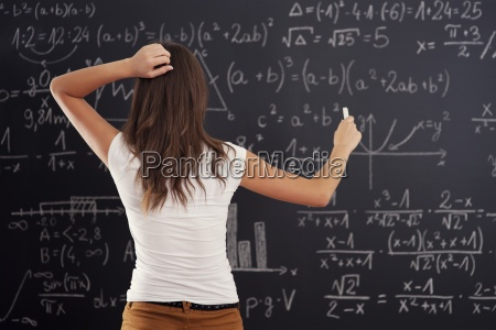 young, woman, looking, at, math, problem - 12113704