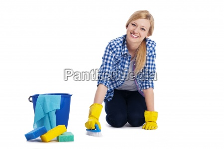 young and smiling woman cleaning a