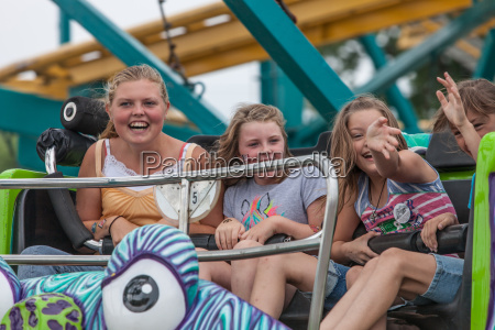 girls on carnival ride at state