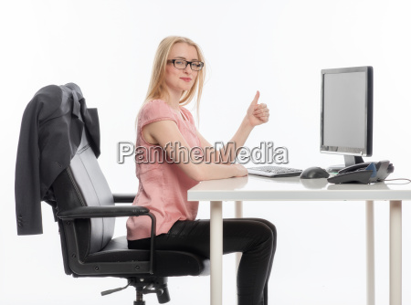 woman in office showing thumbs up