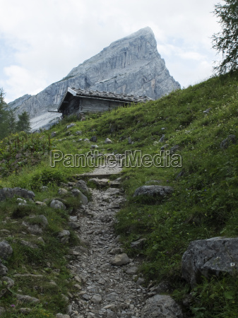 trail and hut in the alps