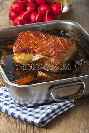 roast pork in a baking dish