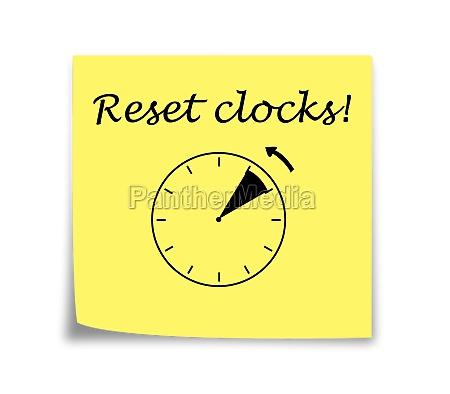 sticky note reminder to set clocks