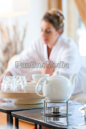 woman drinking tea in the wellness