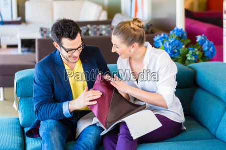 couple looking couch reference in furniture