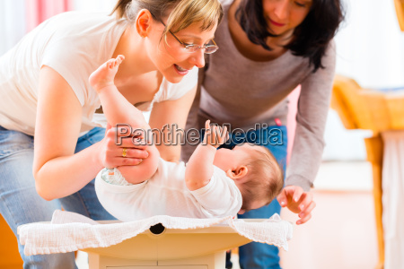 midwife examined infant