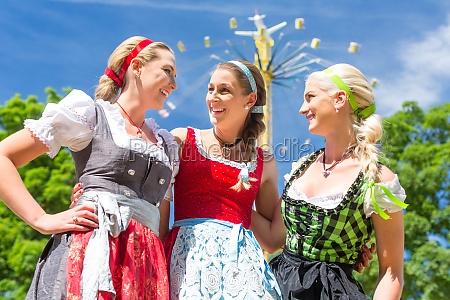girlfriends visit folk festival have fun