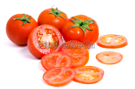 tomatoes with slices on white