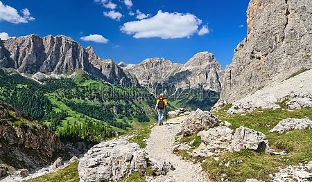 dolomites hiker in badia valley