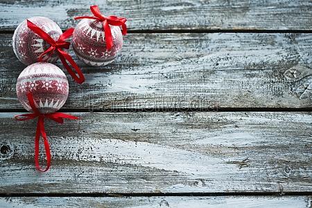 christmas balls on wooden wall