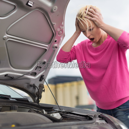 stressed young woman with car defect