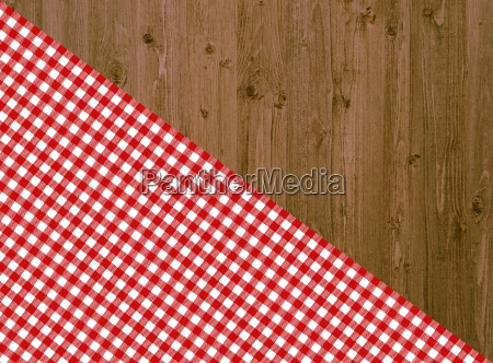 wooden table with diagonal tablecloth in