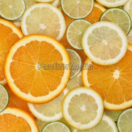 background of fruit including oranges lemons