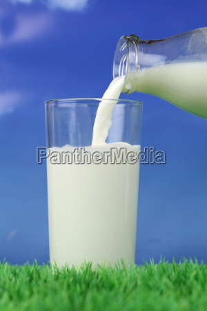 pour milk into a glass