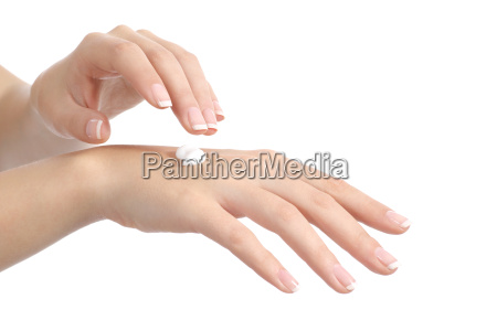 woman hands with perfect manicure applying
