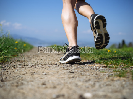 legs of a woman jogger in