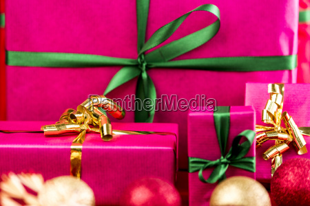 four xmas presents wrapped in plain