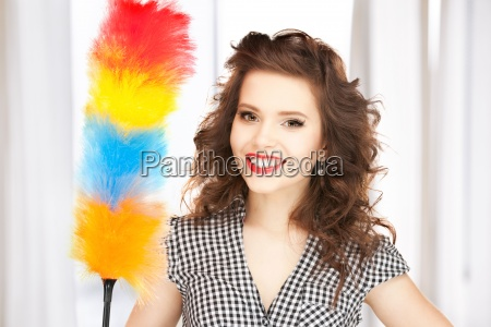 beautiful woman with cleaning sweep