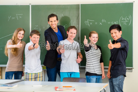 teacher with students in school in