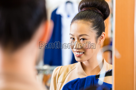 woman trying on clothes in the