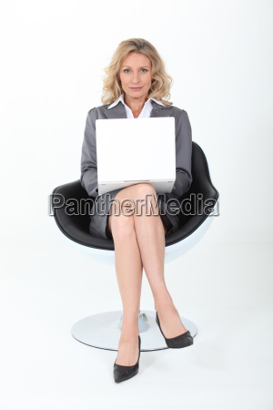 businesswoman sat in modern chair with