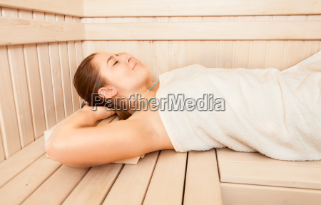 beautiful woman lying on bench at