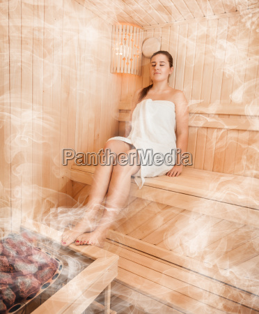 woman in towel relaxing at steamed