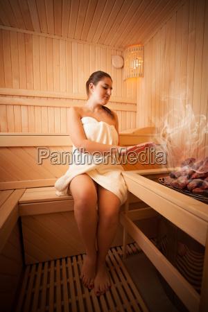 beautiful woman sitting next to oven