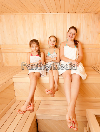 mother with two daughter relaxing at