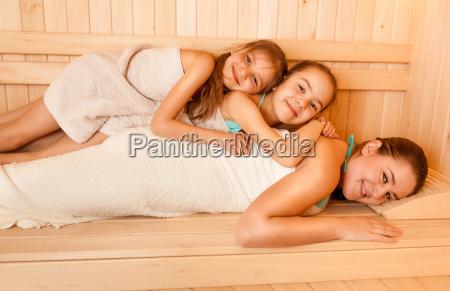 little girls lying on mothers back