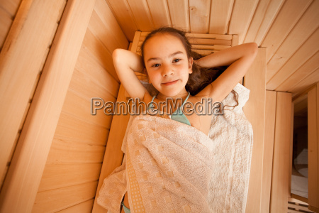 portrait of little girl lying at