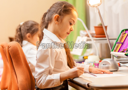 little girls drawing pictures