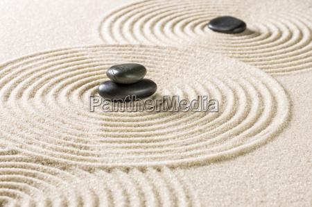 zen garden with black stones