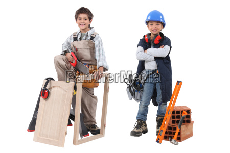 two children acting out adult trades