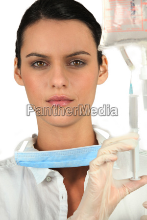 nurse with drip and syringe