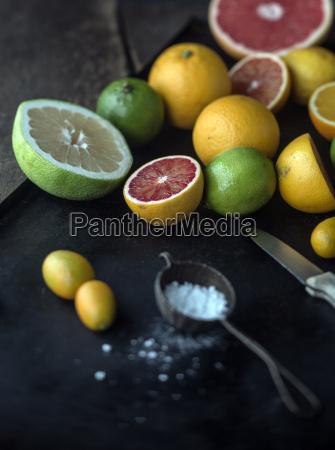 preparing assorted citrus fruit for dessert