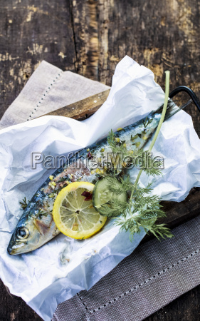 preparing an oven baked fish in