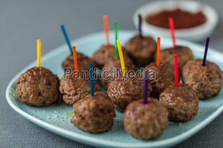 plate of seasoned beef meatballs for