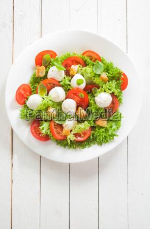 caprese salad with mozzarella pearls and