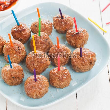 spicy seasoned meatballs on a plate
