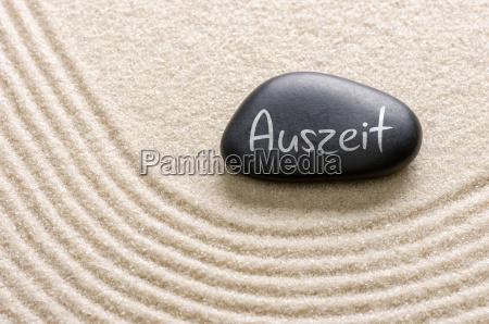 black stone with the inscription auszeit