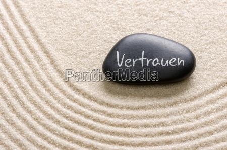 black stone labelled trust