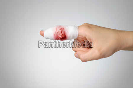 injured finger with bloody bandage